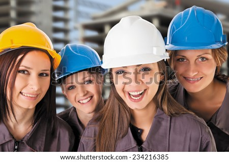 Smiling women construction team with protective clothing. Isolated with work path. - stock photo