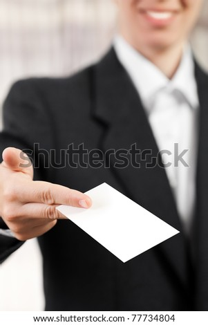Smiling women hand holding empty blank white business card - stock photo