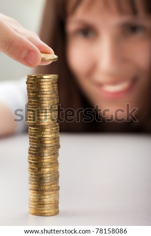 Smiling women hand holding finance currency coins - stock photo