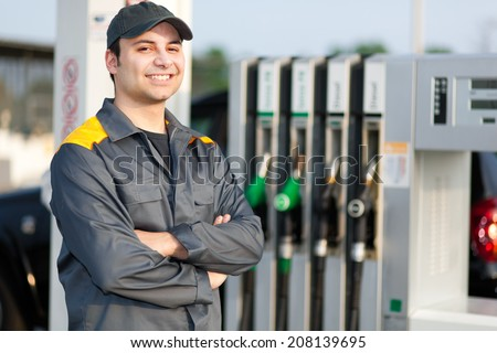 Smiling worker at the gas station - stock photo