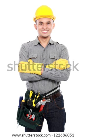 smiling worker crossed his arms and bring equipment ready to work - stock photo