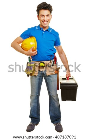 Smiling worker with hardhat and tool belt and toolbox - stock photo