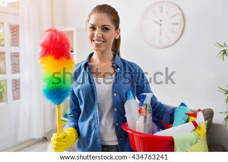Smiling worth girl with the equipment for cleaning - stock photo