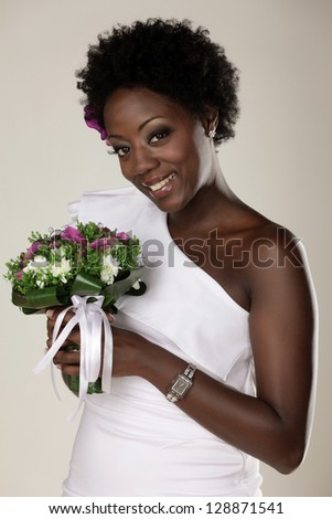 Smiling young African American bride posing in the studio - stock photo