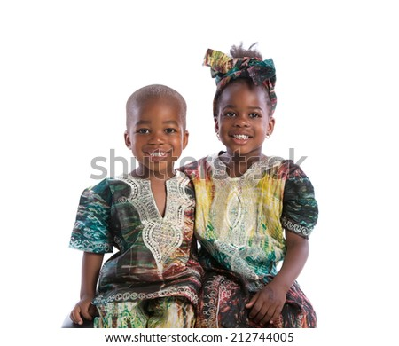 Smiling Young African American Brother and Sister Portrait Isolated on White Background Wearing Colorful African Costume