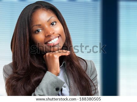 Smiling young african business woman - stock photo