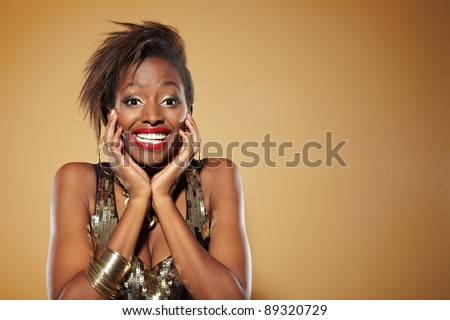 Smiling young african woman looking happy and surprised - stock photo