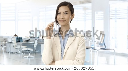 Smiling young asian businesswoman at office. copyspace. - stock photo