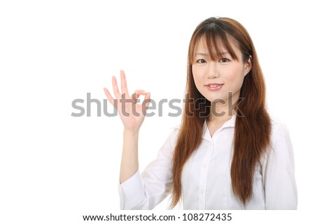 smiling young asian businesswoman with okay gesture - stock photo