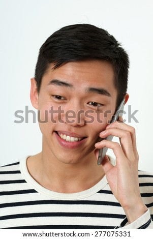 Smiling young Asian man using a smartphone.