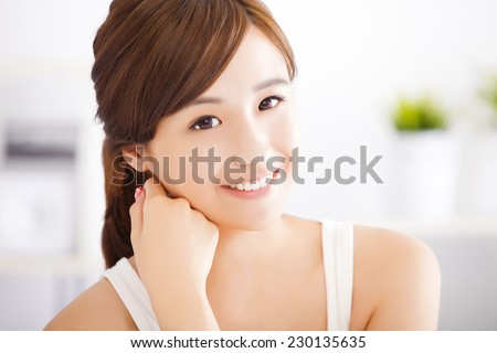 smiling young asian woman face - stock photo