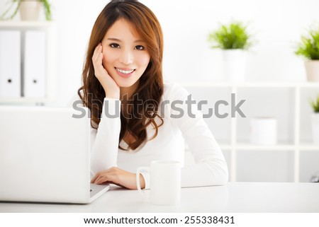 smiling Young asian woman  with laptop - stock photo