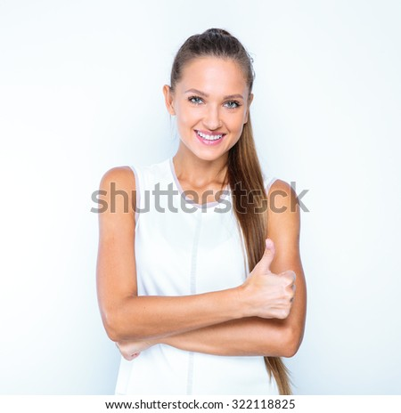 smiling young beautiful woman showing thumbs up, portrait of a girl isolated on white background