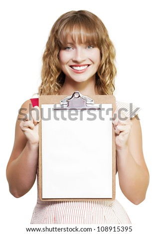 Smiling young blonde secretary or personal assistant holding up a clipboard with a blank sheet of white paper for your announcement or advertisement isolated on white - stock photo
