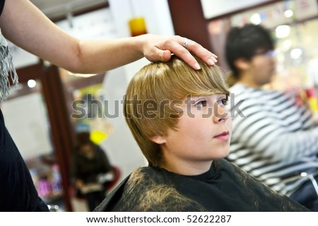 smiling young boy at the hairdresser