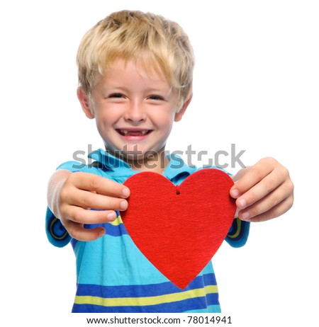 Smiling young boy holds out a red heart , isolated on white - stock photo