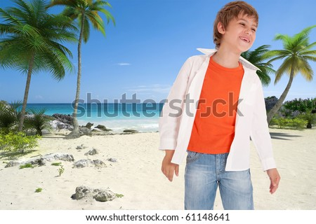 Smiling young boy on a tropical beach - stock photo