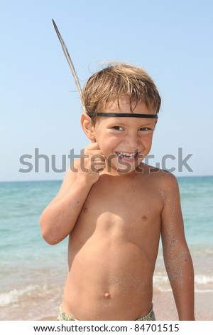 smiling young boy on sea background - stock photo