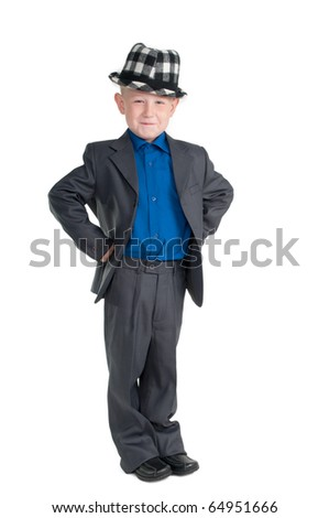 Smiling young boy with chequered hat and suit - stock photo