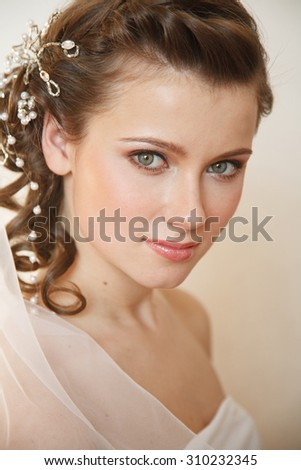 Smiling young  bride. professional hairstyle and make-up - stock photo