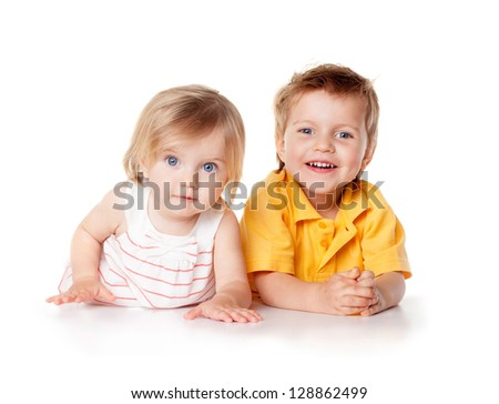Smiling young brother and sister Isolated - stock photo