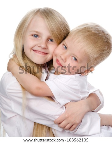 Smiling young brother and sister. isolated on white background - stock photo