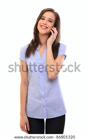 smiling young brunette woman talking on cellphone - stock photo