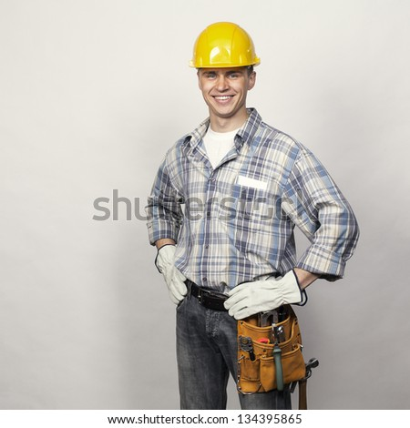 smiling young builder - stock photo