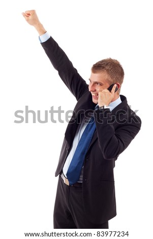 smiling young business man discussing on a cell phone and winning, isolated on white background