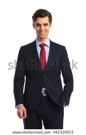 smiling young business man in suit and tie standing on white studio background