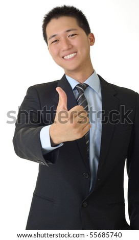 Smiling young business man of Asian giving you a thumbs up sign isolated against white. - stock photo