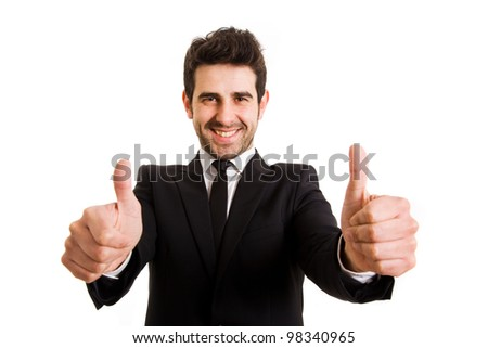 Smiling young business man thumbs up, isolated on white - stock photo