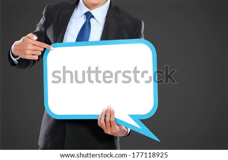 smiling young business man with balloon text - stock photo
