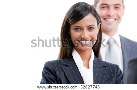 Smiling young business people standing in a row against a white background - stock photo