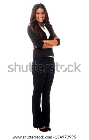 Smiling young business professional posing confidently in studio. - stock photo