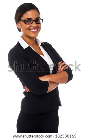 Smiling young business professional posing with arms crossed. - stock photo