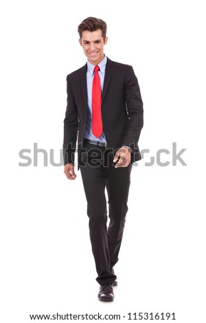 smiling young business walking forward to the camera on white background - stock photo