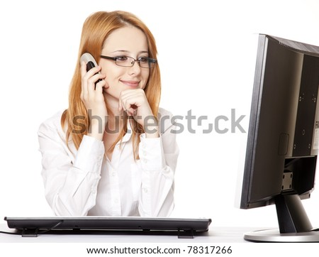 Smiling young business woman calling by phone.