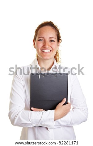 Smiling young business woman embracing a clipboard
