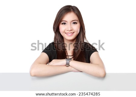 smiling young business woman showing blank signboard, isolated on white background - stock photo