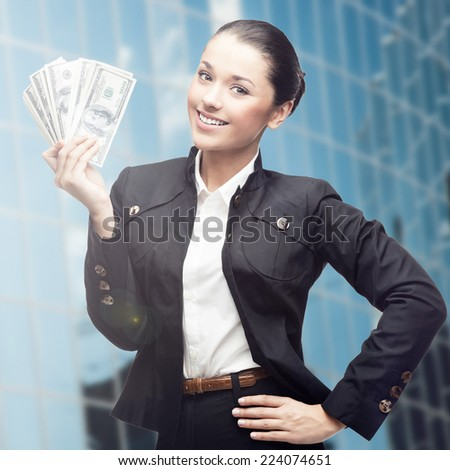 smiling young business woman standing over blue background - stock photo