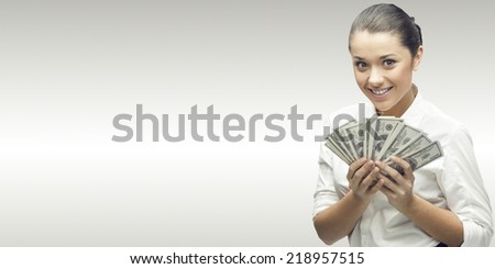 smiling young business woman standing over gray background - stock photo