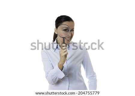 smiling young business woman with magnifying glass in the eye isolated on a white background - stock photo