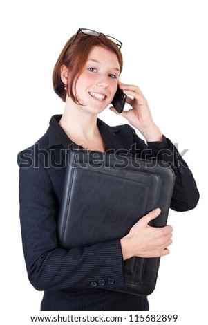 Smiling young business woman with smart phone
