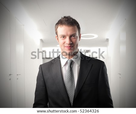 Smiling young businessman - stock photo