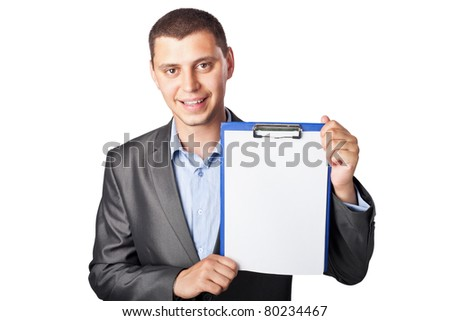 smiling young businessman holding clipboard isolated on white background - stock photo