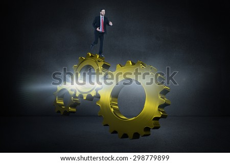 Smiling young businessman in suit running against black wall - stock photo