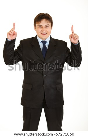 Smiling young  businessman pointing up  isolated on white
