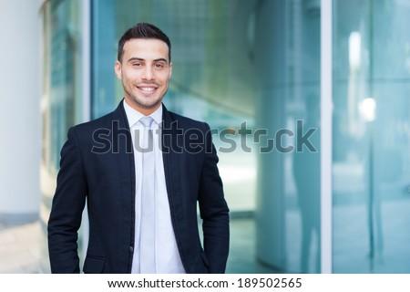Smiling young businessman portrait - stock photo