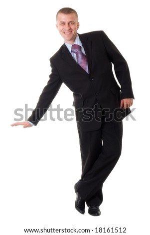 smiling young businessman standing against isolated white background